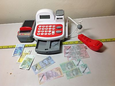 Children's cash reigster with functioning calculator, money, and microphone