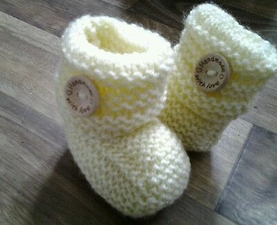 Hand knitted yellow baby booties 0-6 months