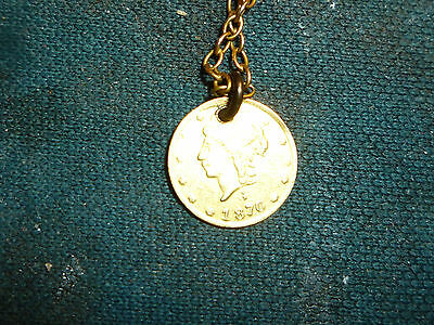 1870 1/4 dollar Cal. gold coin with 14 inch chain
