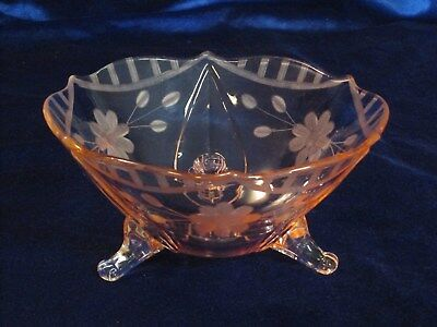 Early 20th century berry bowl with lovely, hand cut, design in pretty pink color