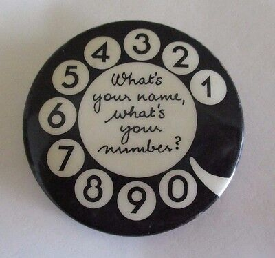 'What's your name, what's your number?' Black and White Phone Dial Badge - 1970s