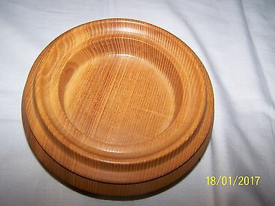 Light wood circular bowl, pointed  sides  - 18cms (D)