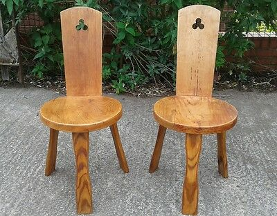 2 solid yew 3 legged chairs by Reynolds of Ludlow