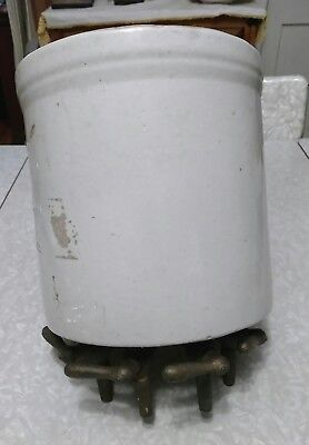 Antique stoneware crock with 4 brass valves. Water filter?