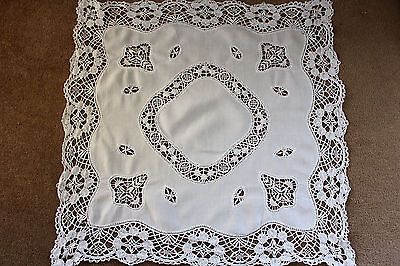 Vintage small white linen tablecloth with embroidered centre and edges.