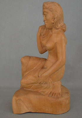 Wooden statue of a woman in half kneeling pose - Bali - Indonesia 1940-1950