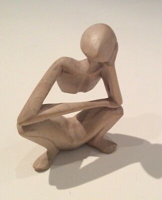 hand carved wood figure thinking