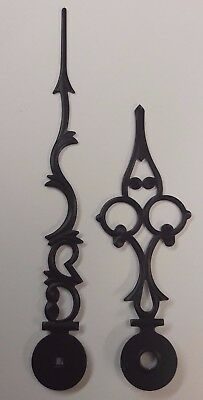A Pair Of Small Stylish Embossed Clock Hands.