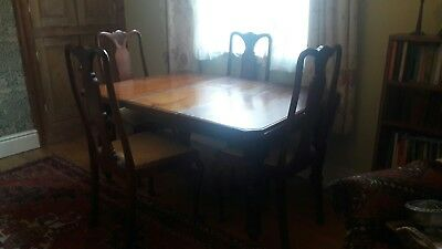Edwardian mahogany wind out dining table and four chairs