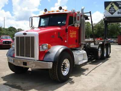 2005 Peterbilt 357 Roll-Off Truck With 50 Roll-Off Containers, One Owner, Fla