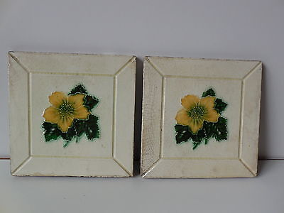 A Pair Of Antique Victorian Tiles With Molded Yellow Flower Design