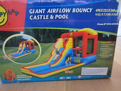 Giant kids inflatable jumping castle + slide + pool. Blower included