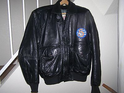 men's size Large (44) black leather bomber jacket with patch/lined/epelets