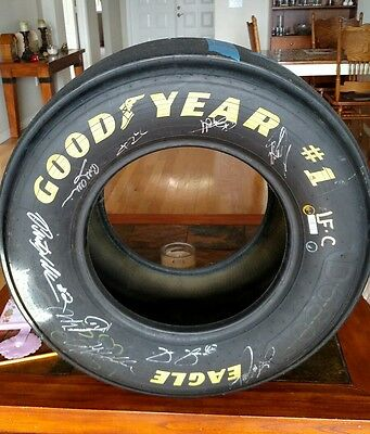 NASCAR #20 Home Depot Used Tire Autographed by 9 Series Champions