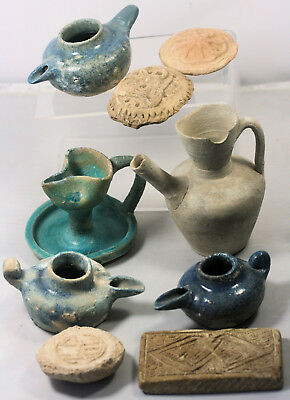 Nine ancient Islamic oil lamps, pottery and moulds or seals