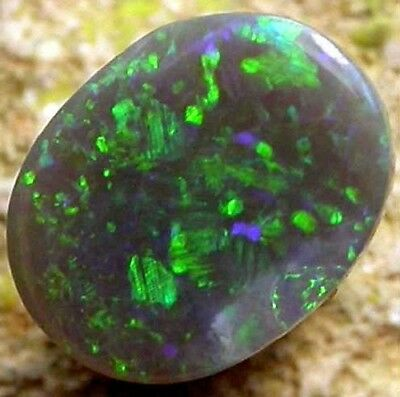 A well polished black opal from Lightning Ridge