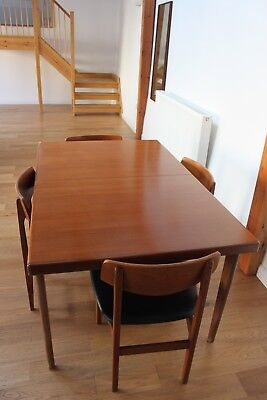 Teak 1960's extending dining table and four chairs in good vintage condition.