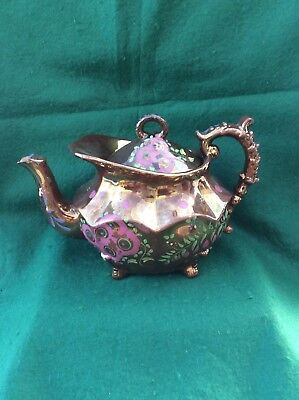 Victorian Staffordshire copper lustre tea pot