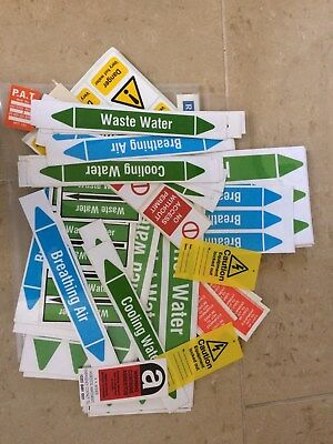 A pack of internal building labels - various types, warning - marking etc