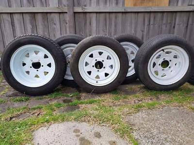 Brand new Ford pattern 5 Trailer rims with used tyres for sale.