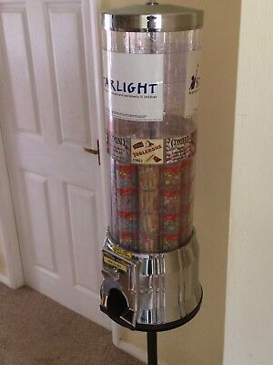 Tower vending machine with stand takes new £1 in good working order.
