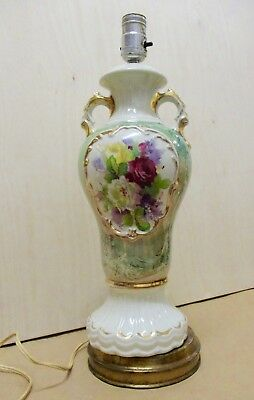 Vintage porcelain lamp with hand painted flowers and gilded handles