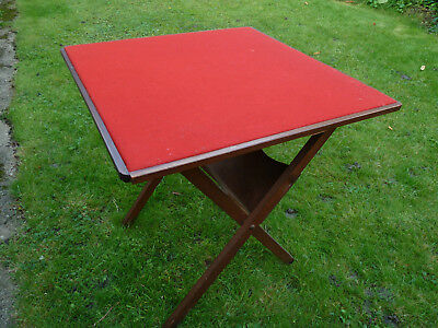 Vintage folding card table with red baise top