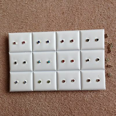 JOB LOT-12 pairs of 0.4cm diamonte stone.Mix of 10 colours stud earrings.UK made