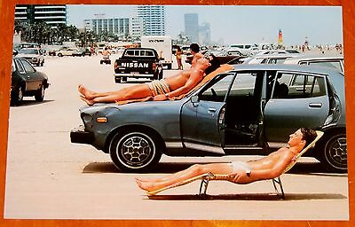80S Picture People Sun Tanning At Daytona Beach With 70S Datsun B210 - Old Cars