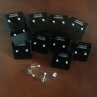 JOB LOT 10 pairs of 0.2 cm crystal diamonte stud earrings. Silver plated.