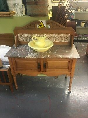 Victorian washstand with tile back and marble top On Metal Casters