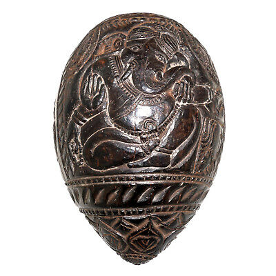 (1811) Coconut shell with a carved Ganesh. India. Part of water pipe.