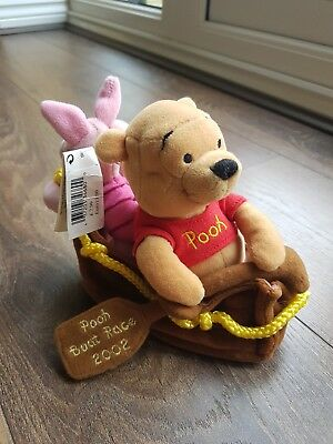 Pooh bear and piglet in boat beanie. Pooh boat race 2002