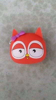 Justice orange owl coin holder with purple bow.