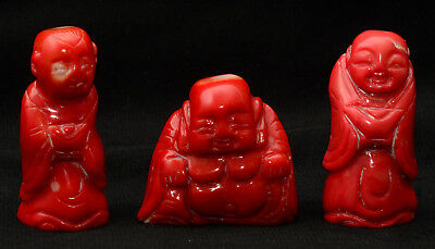 Group of three Chinese red coral colored carvings