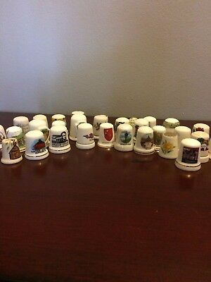 29 vintage porcelain thimbles and 1 small bell- states, flowers, cities and more