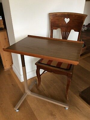 Adjustable Portable Table Over Bed.  On castors, easy wipe clean. Ideal for home