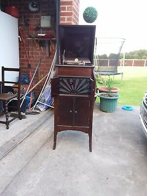 antique wind up gramaphone in ornate cabinet