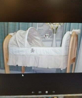 Eddie Bauer musical Wood Bassinet natural wood color.