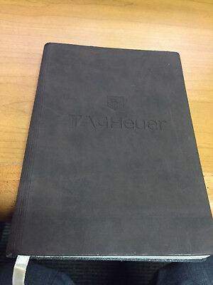 Tag Heuer note pad with brown soft touch material.