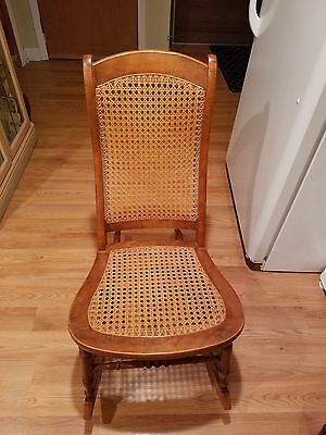 Antique cane rocker. Excellent condition. Local pickup only.