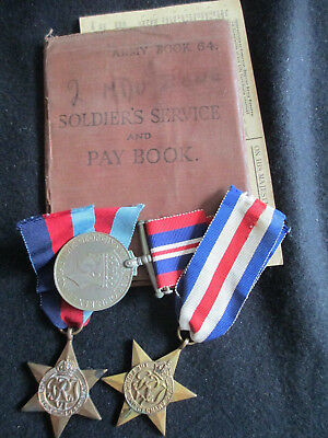 WW2 British War Medals/Soldiers Service & Pay Book. Royal Artillery. Sgt. Gibson
