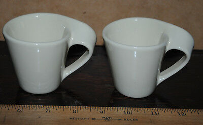 Pair of espresso cups unmarked funky handle