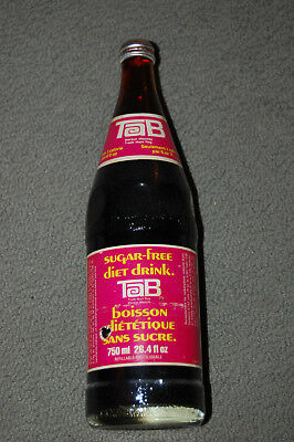 Vintage Sealed 26.4 oz. Full Glass Bottle of TaB diet soda - a Coca-Cola Company