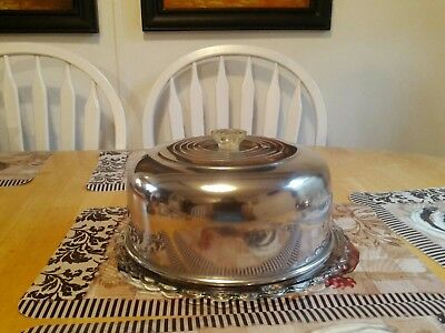 a vintage metal cake cover with footed glass cake plate mid-century