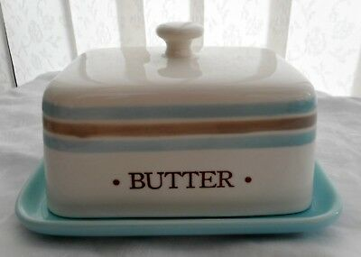 Butter dish & lid. Ivory, blue and taupe with hen and Butter to each side.