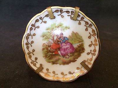 SWEET LITTLE VINTAGE 7cm LIMOGES FRANCE COURTING LOVERS PLATE ON BRASS STAND