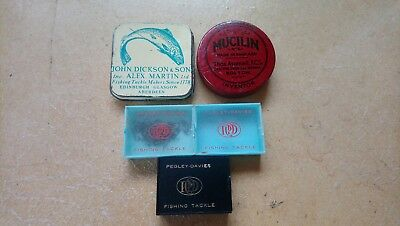 A selection of old tackle tins and boxes