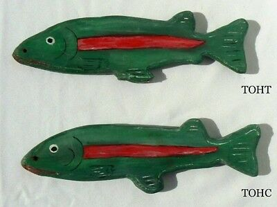 Pair of painted wooden fish decoys in greens, red, white, and black.