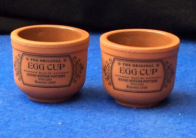 Pair of Henry Watson Pottery brown terra cotta egg cups